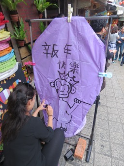 Drawing a monkey on our lantern for the Year of the Monkey